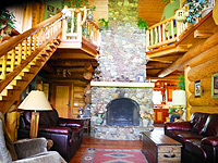 A cozy lounge in the lodge has a fireplace as its focal point.